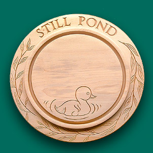 Bread board with a call duck centre engraving