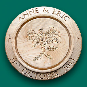 Centre engraved bread board with a rose and thistle.